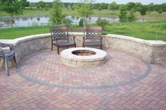 Pavers, patio, brick patio, brick firepit, retaining wall.